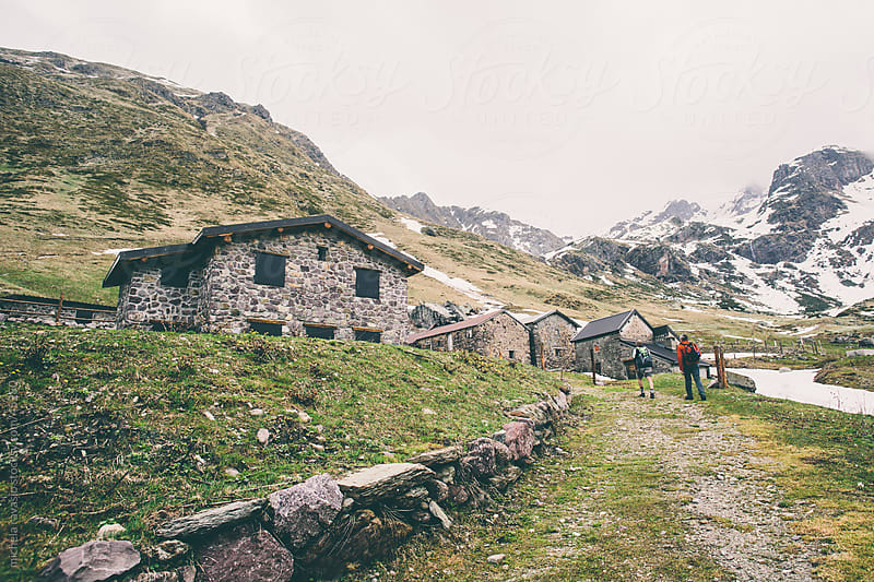 Hikers on a mountain path by michela ravasio for Stocksy United