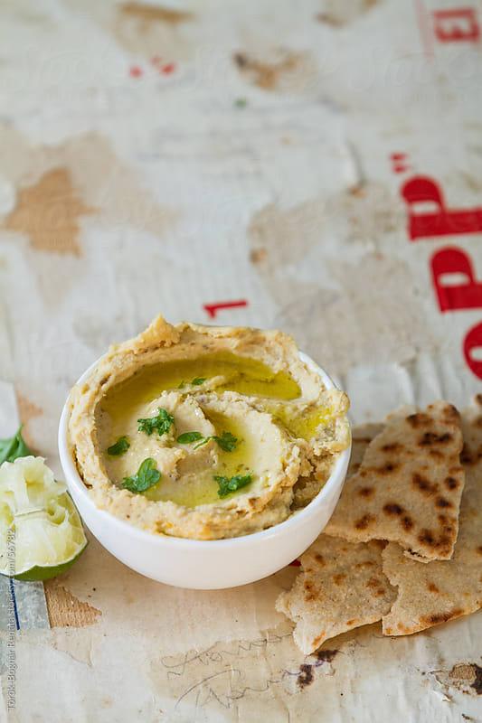 Hummus with flatbread by Török-Bognár Renáta for Stocksy United