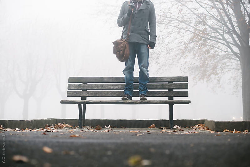 Man standing in the fog  by GIC for Stocksy United