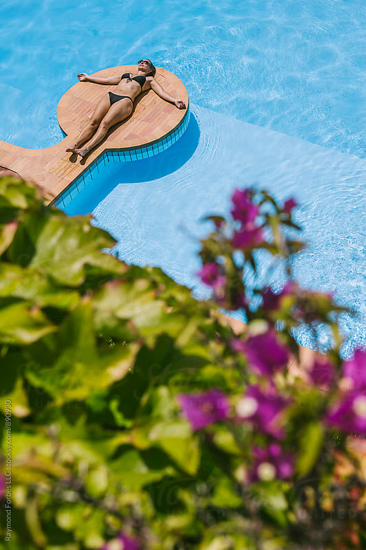 Woman at Swimming Pool at Summer Villa Italy by Raymond Forbes LLC for Stocksy United