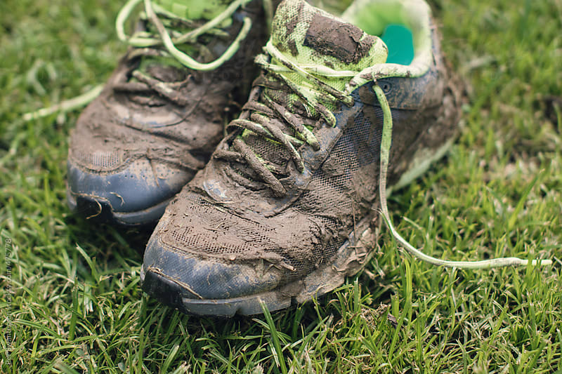 Closeup of dirty sport shoes after exercise by Per Swantesson for Stocksy United