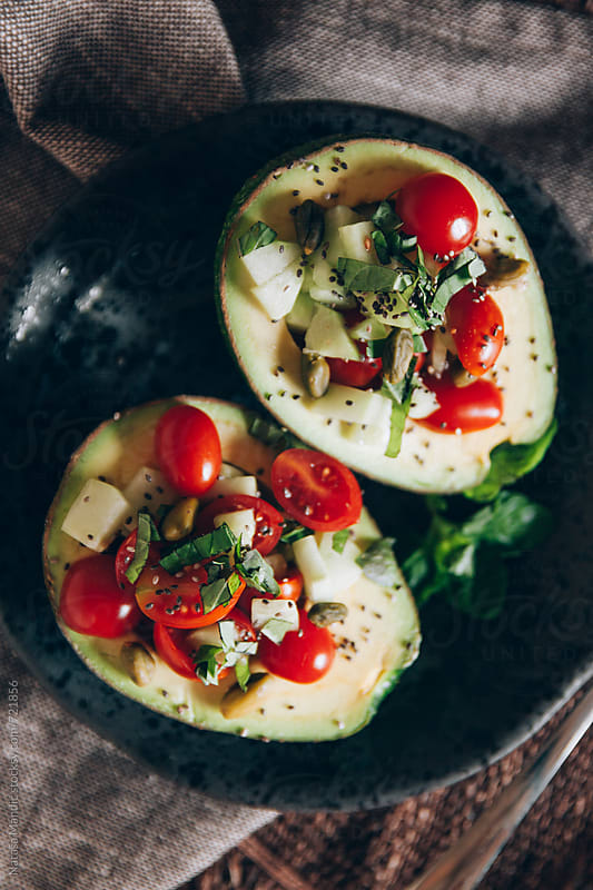 Avocado salad with cherry tomatoes, cucumbers and mint by Nataša Mandić for Stocksy United