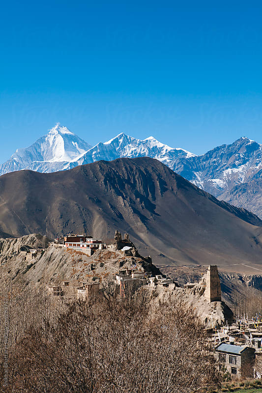 The village of Jhong perched on a hill in Mustang Region, Nepal. by Shikhar Bhattarai for Stocksy United