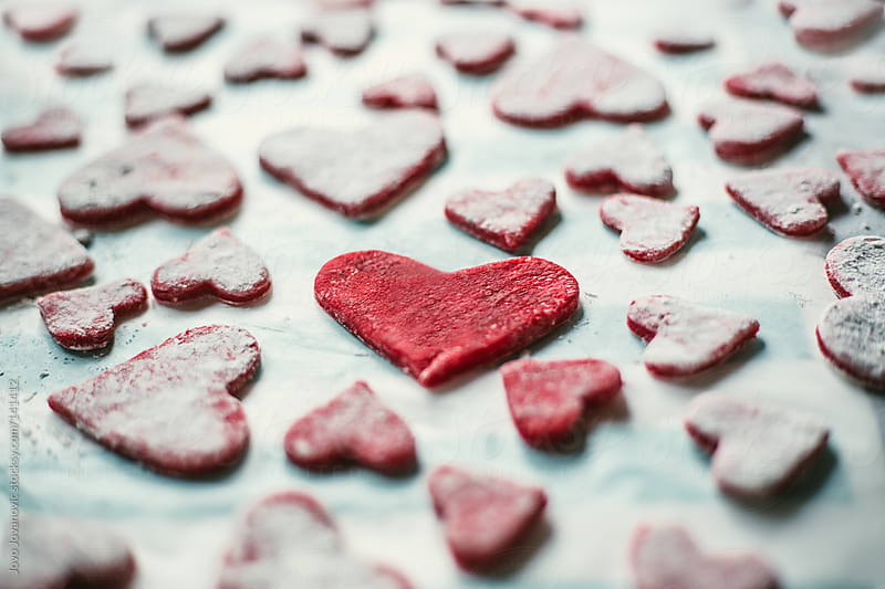 Making Valentine's day cookies at home.  by Jovo Jovanovic for Stocksy United