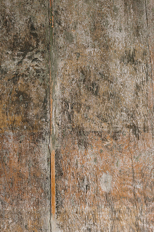 Old grungy stained wooden door texture by Amir Kaljikovic for Stocksy United