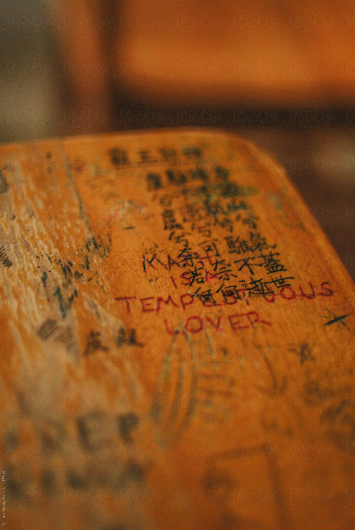 graffiti scratched into school desk top by Margaret Vincent ...