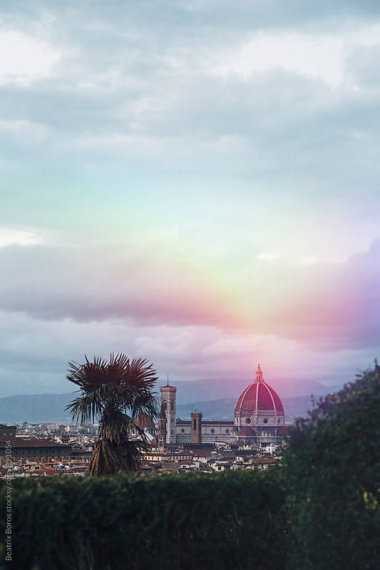 The duomo and the bell tower framed by vegetation by Beatrix Boros for Stocksy United