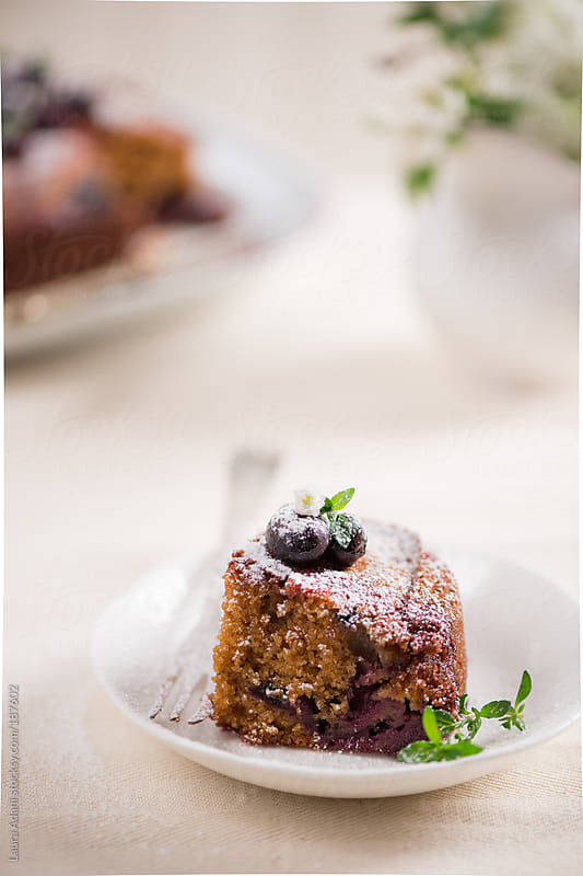 a slice of blueberries cake by Laura Adani for Stocksy United