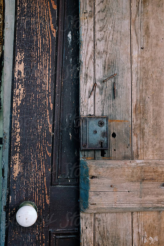 Textures of old wooden doors with ornately carved details by Greg Schmigel for Stocksy United