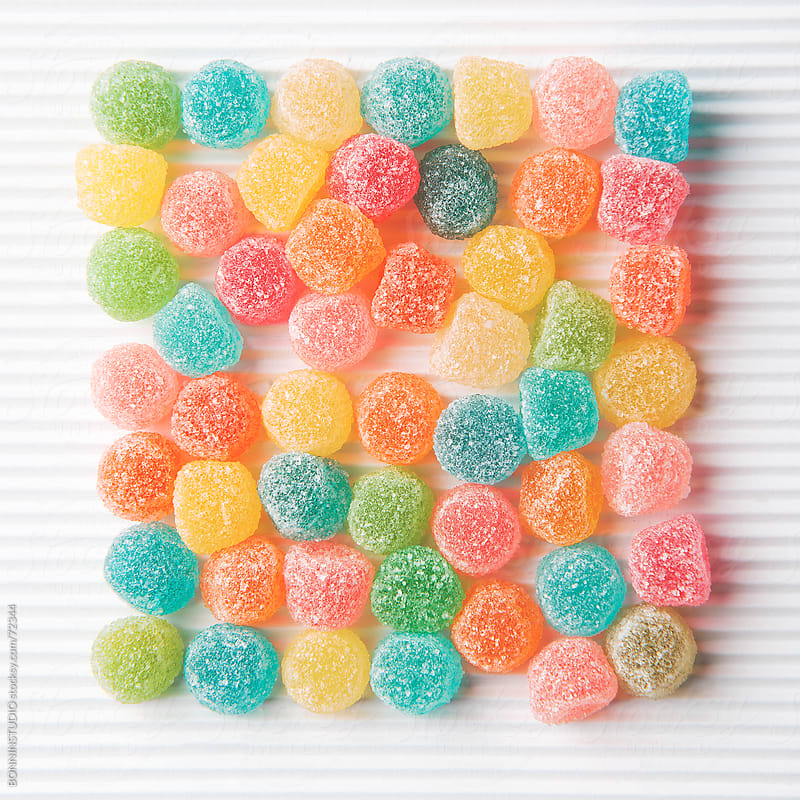 Colourful sugar candy on white background. by BONNINSTUDIO for Stocksy United