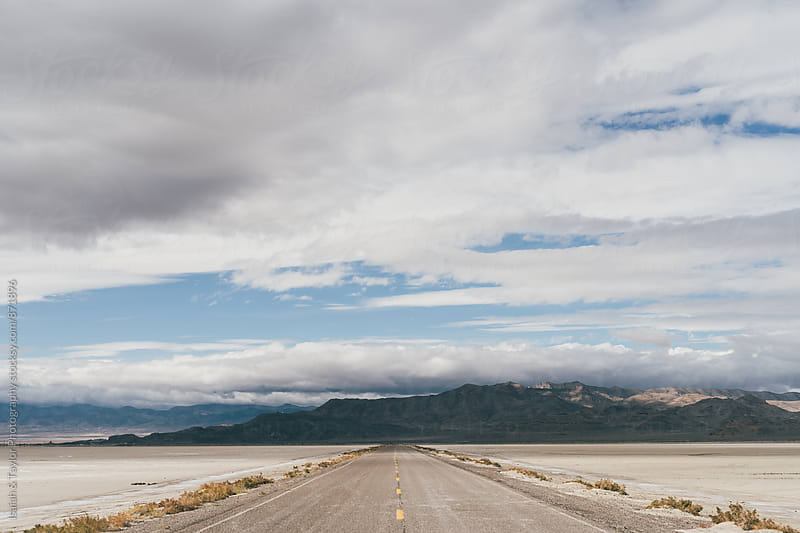 Lonesome road in desert by Isaiah & Taylor Photography for Stocksy United
