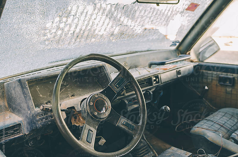 interior of abandoned car by Javier Pardina for Stocksy United
