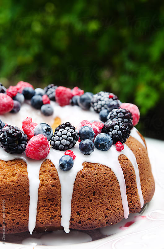 Gourmet dessert cake with berries  by Jill Chen for Stocksy United