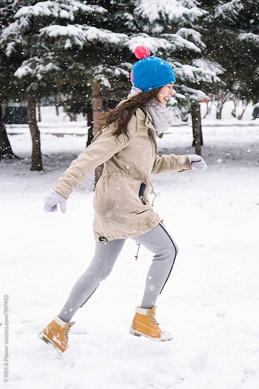 Smiling young woman running in park by Danil Nevsky for Stocksy United