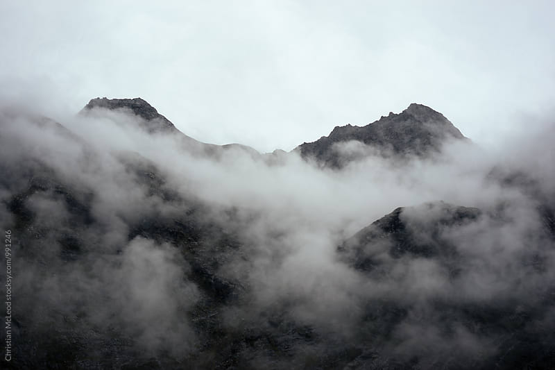 Mountain Fog creeps through the valley by Christian McLeod Photography for Stocksy United