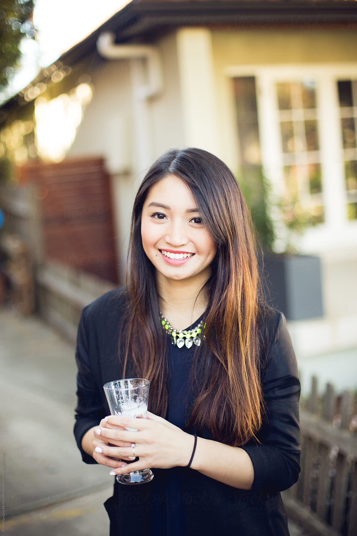 A Pretty Vietnamese Girl With A Drink  Stocksy United-5124