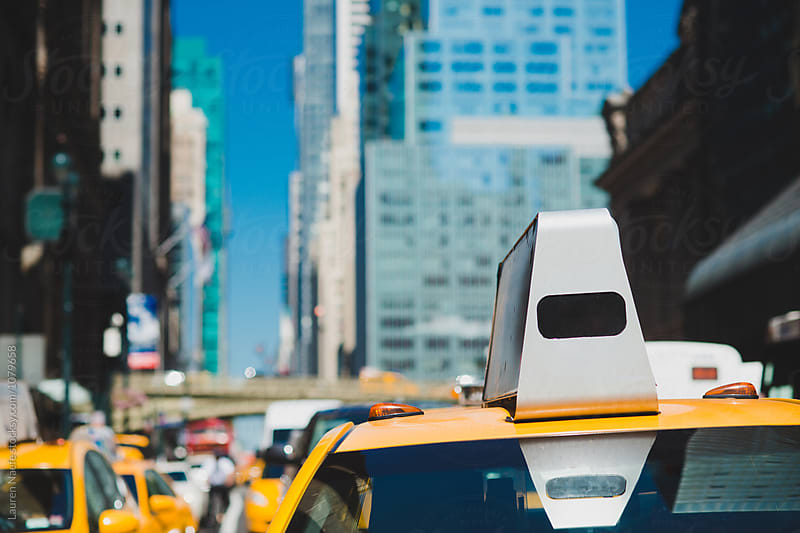 Yellow taxi cabs in the city by Lauren Naefe for Stocksy United