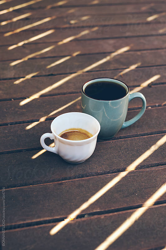Two coffee cups on wooden background.  by BONNINSTUDIO for Stocksy United