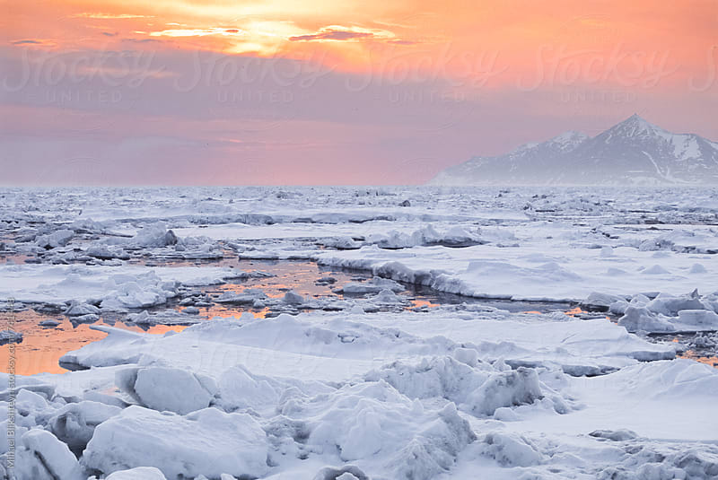 Landscape view of an orange sunset over ice floats in the Bering Sea in Alaska by Mihael Blikshteyn for Stocksy United