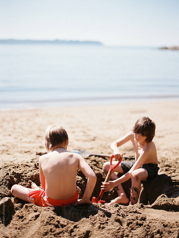 kids playing at the beach by Kirill Bordon photography for Stocksy United