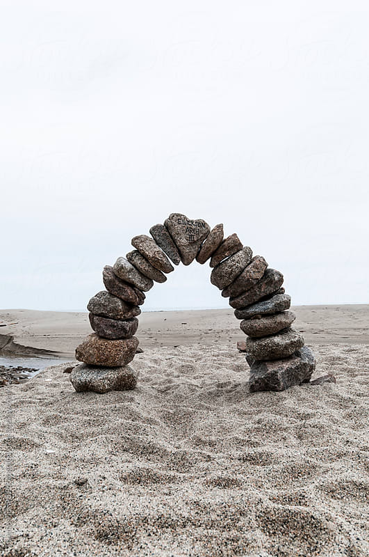 Rock arch on beach, Heaphy Track, West Coast, New Zealand. by Thomas Pickard for Stocksy United