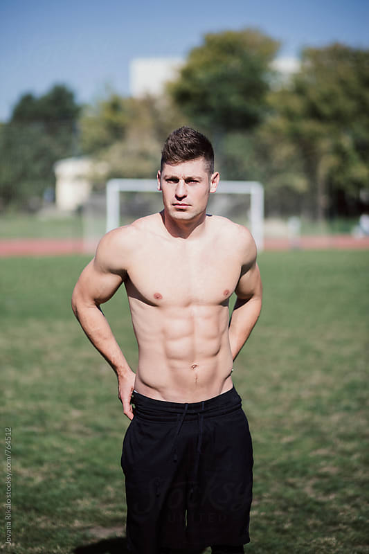 Man resting during workout outdoors by Jovana Rikalo for Stocksy United