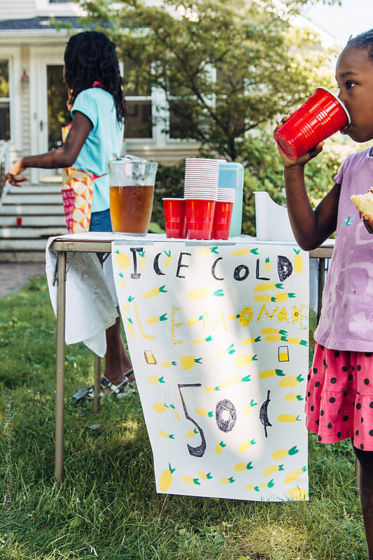 African American girl drinking lemonade by Gabriel (Gabi) Bucataru for Stocksy United