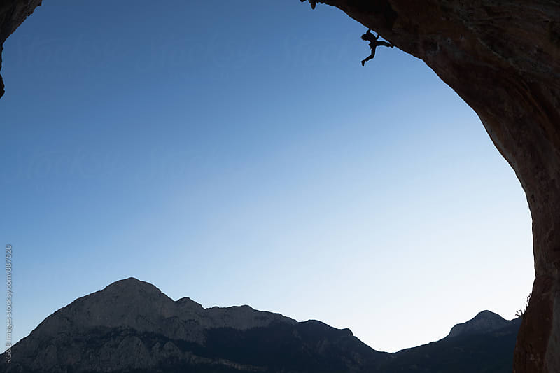 Climber silhouette climbing a overhanging wall by RG&B Images for Stocksy United