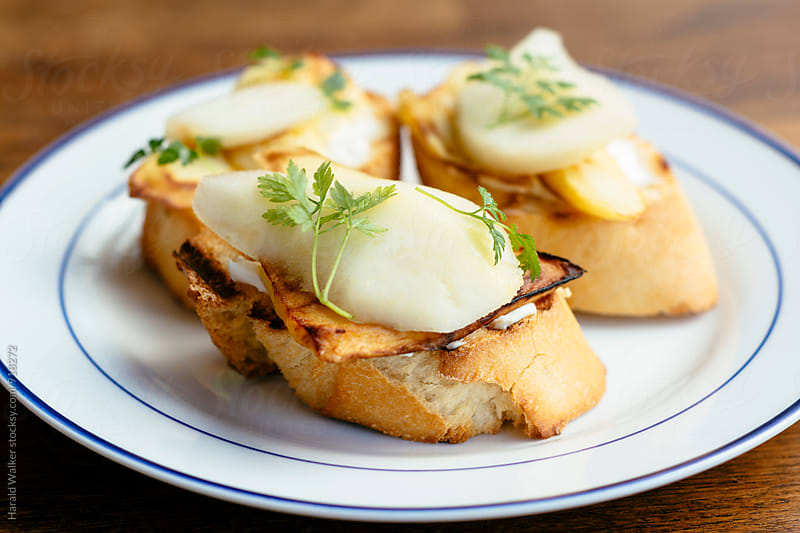 Parsnip, Pear and Vegan Ricotta Bruschetta by Harald Walker for Stocksy United