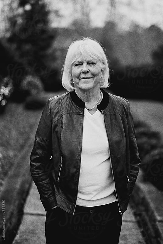 Portrait of a cool senior woman in a leather jacket by Jakob for Stocksy United