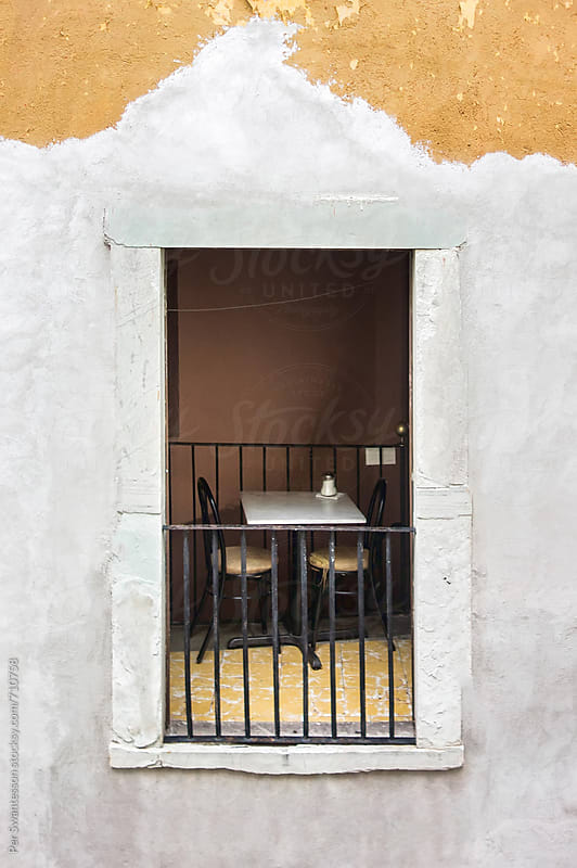 Peek into 2nd floor of old Mexican café by Per Swantesson for Stocksy United