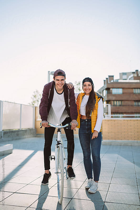 Happy Teenager Couple in a Sunny Day by VICTOR TORRES for Stocksy United