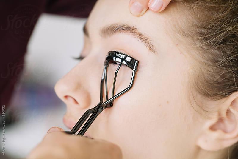 Makeup artist applying eyelash curler by Alberto Bogo for Stocksy United