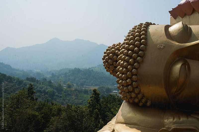 Buddha statue by Chalit Saphaphak for Stocksy United