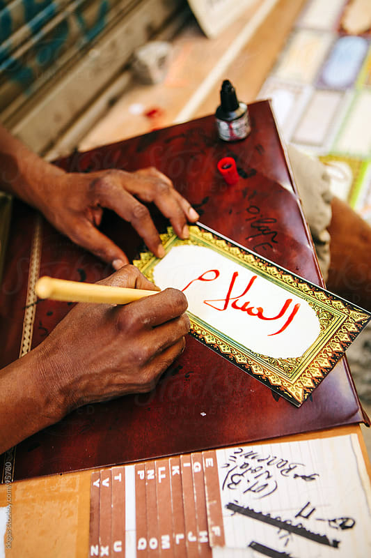 Mans hands writing in arabic caligraphy by kkgas for Stocksy United