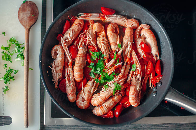 Cooking prawns by Davide Illini for Stocksy United