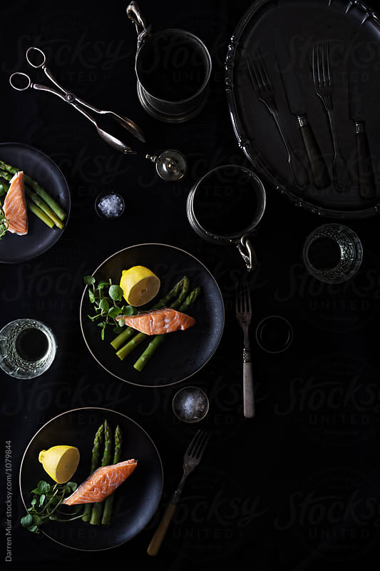 Salmon with asparagus and watercress meal. by Darren Muir for Stocksy United