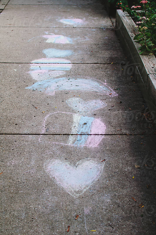 chalk drawings on sidewalk by Margaret Vincent for Stocksy United