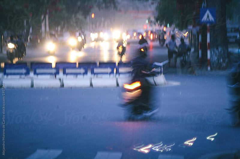Moped city traffic at night by Alejandro Moreno de Carlos for Stocksy United