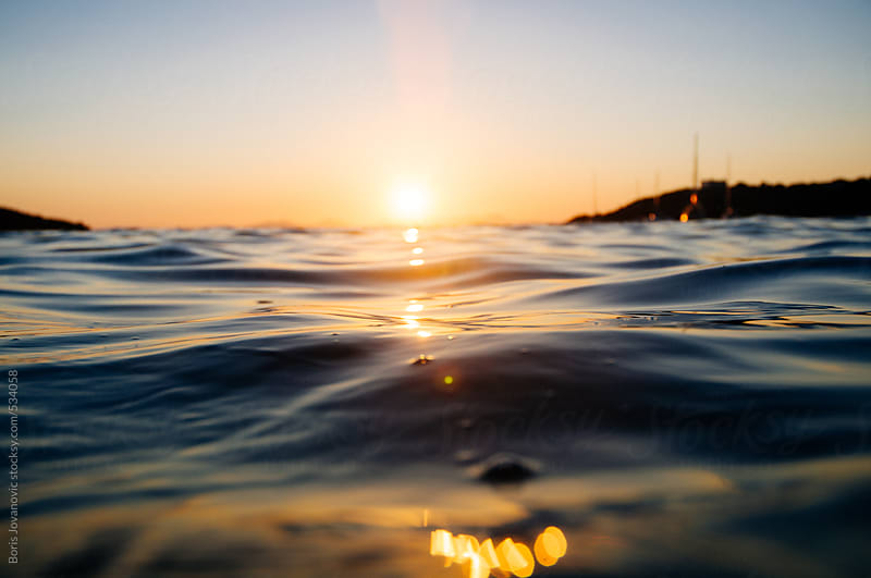 Beautiful sunset over sea surface by Boris Jovanovic for Stocksy United