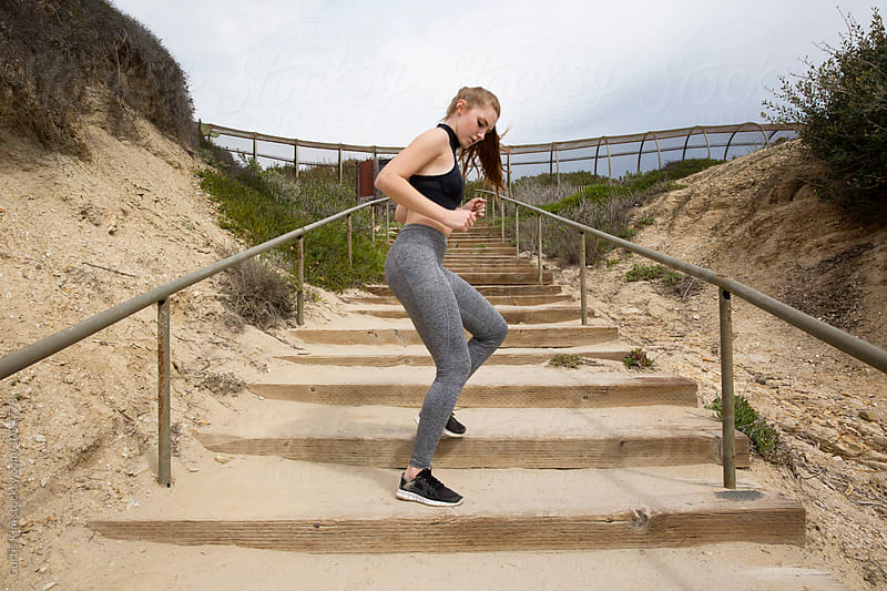 Athletic woman working out on stairs by Curtis Kim for Stocksy United