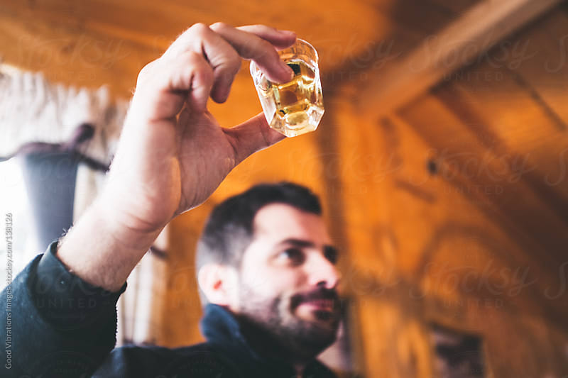 Man drinking brandy by Good Vibrations Images for Stocksy United