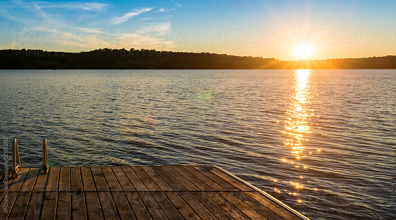 Warm Summer Cottage Lake At Sunset from Dock Landscape by JP Danko for Stocksy United