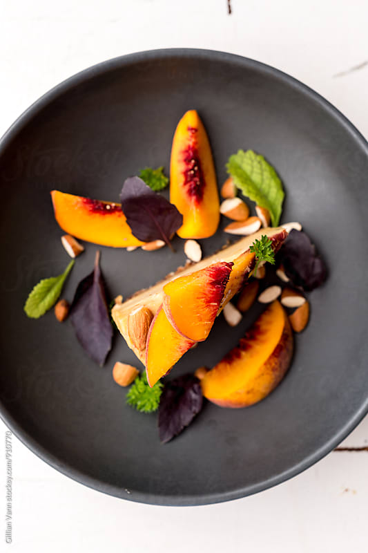 raw vegan peach cheesecake by Gillian Vann for Stocksy United