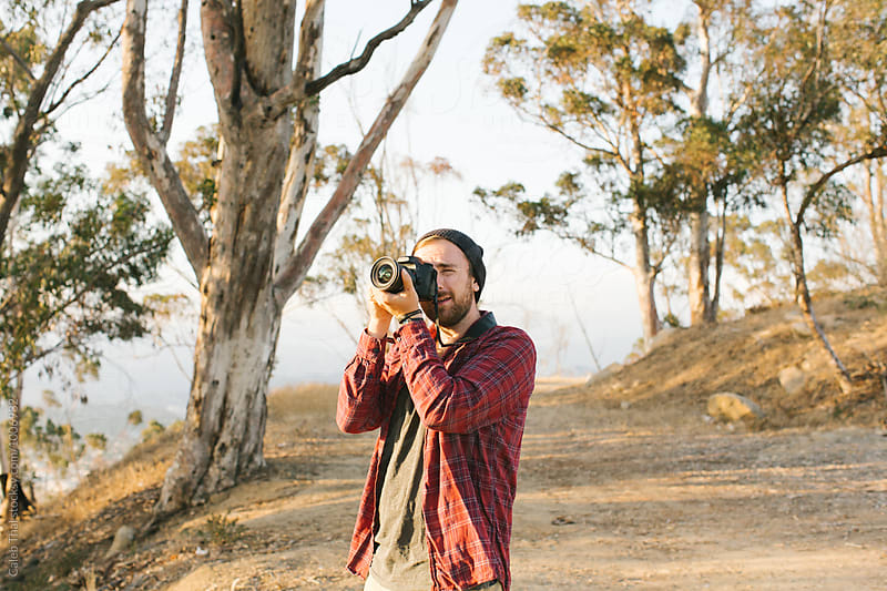 A Young Man Taking A Photo With A Digital Camera by Caleb Thal for Stocksy United