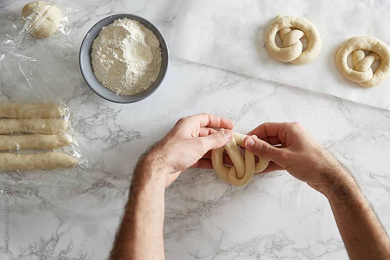 Shaping pretzels dough by Martí Sans for Stocksy United