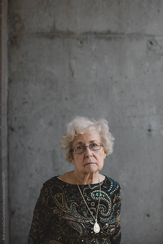 Serious portrait of senior caucasian woman outside by Rob and Julia Campbell for Stocksy United