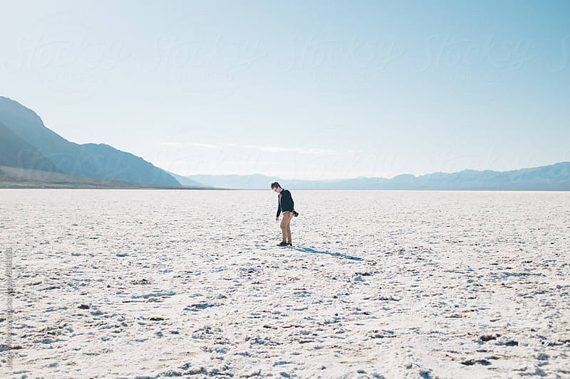 male in desolate landscape salt flat california by Jesse Morrow for Stocksy United
