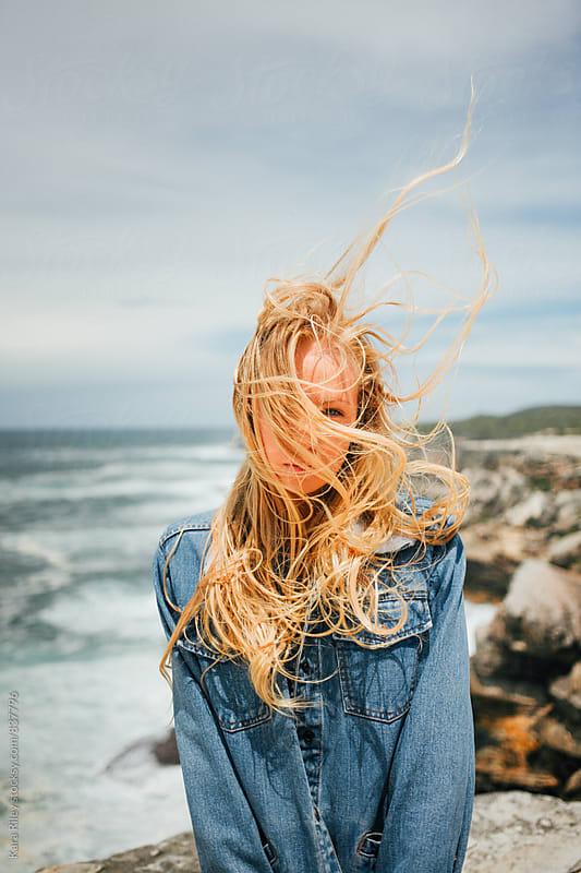 Blonde hair blowing in the wind by Kara Riley for Stocksy United
