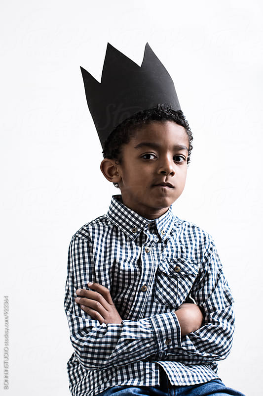Portrait of a boy wearing a black crown. by BONNINSTUDIO for Stocksy United